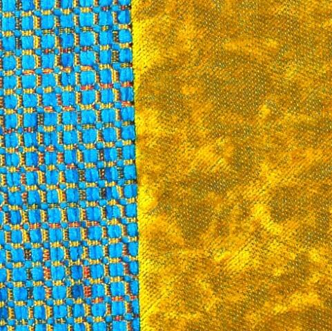 Ein farbenfrohes Kissen-Unikat von AN-NA Design in den Farben Blau, Türkis und Gelb.