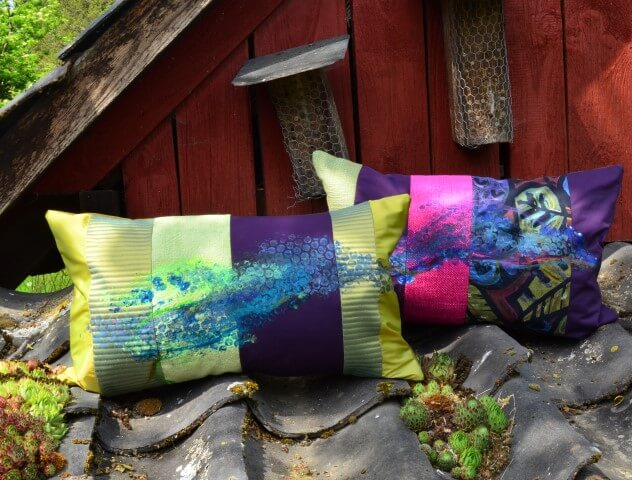 Zwei Kissen als Kunst-Objekte von AN-NA Design, handbemalt und handbedruckt.